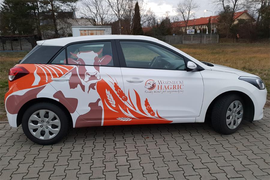 Reklama na samochodzie Woźniecki HAGRIC